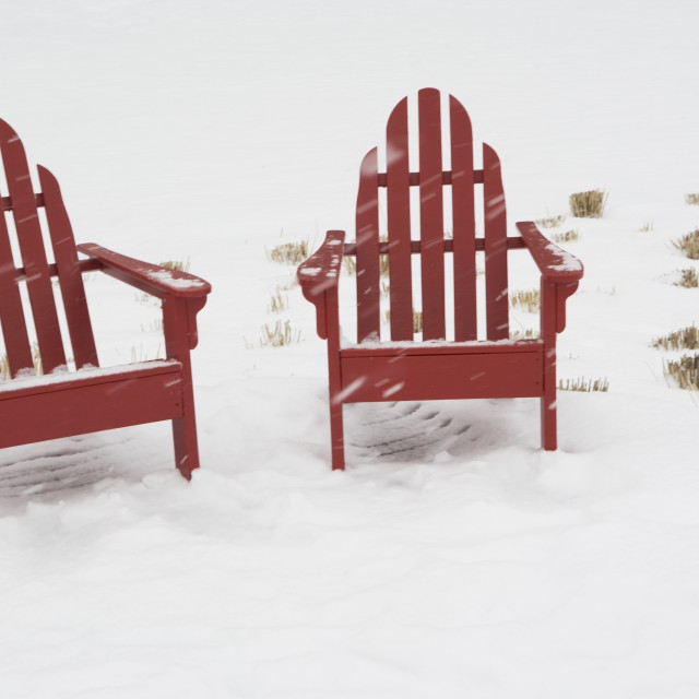 """""""USA, New York City, two adirondack chairs in snow"""" stock image"""
