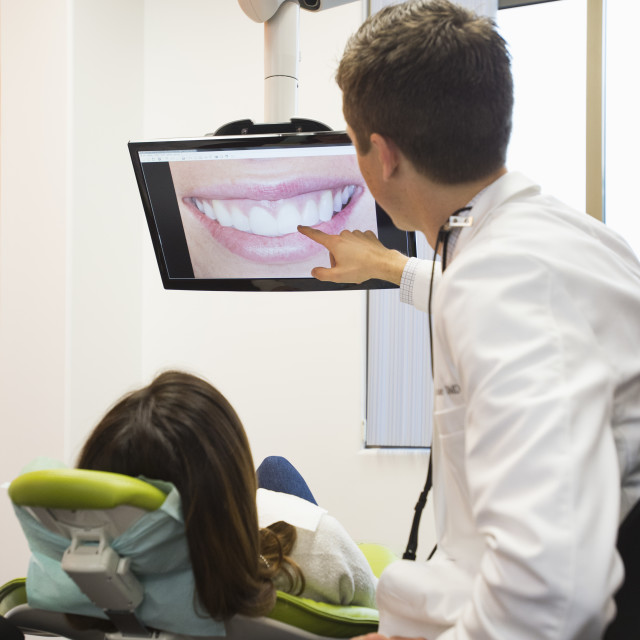 """Dentist and patient looking at screen"" stock image"