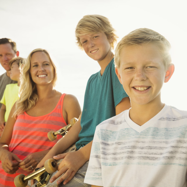 """""""Portrait of with three children (6-7, 10-11, 14-15) on vacation"""" stock image"""