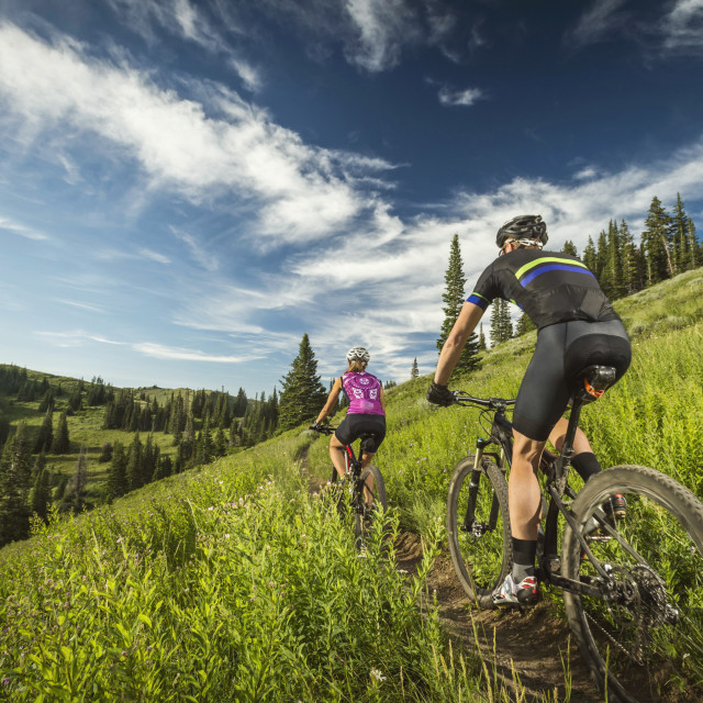 """""""Mature couple during bicycle trip in mountain scenery"""" stock image"""