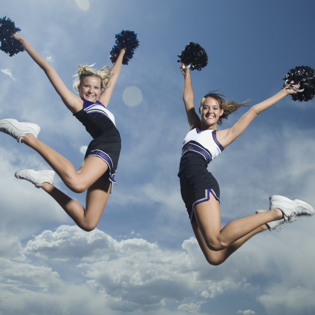 """Cheerleaders with pom poms jumping"" stock image"