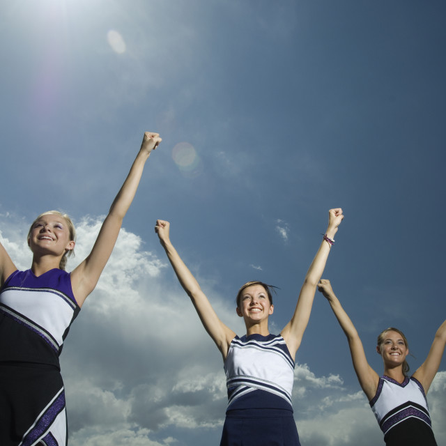 """""""Cheerleaders with arms raised"""" stock image"""
