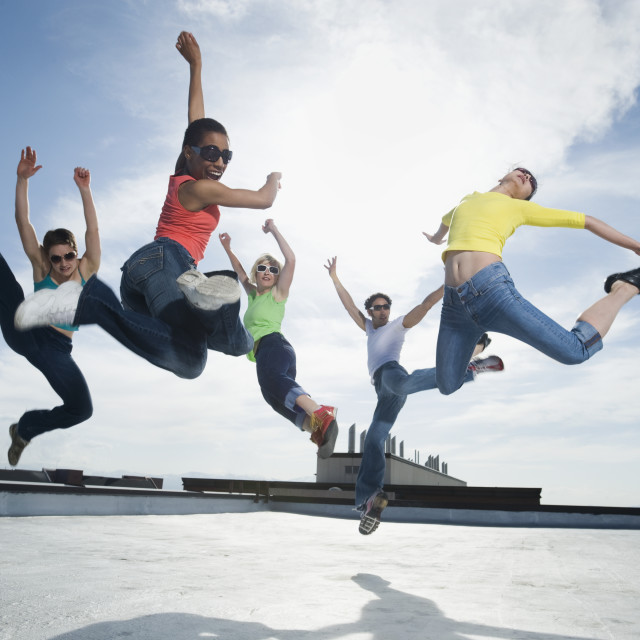 """Multi-ethnic group performing modern dance"" stock image"