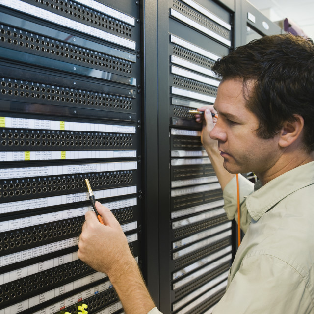"""Man working in data center"" stock image"