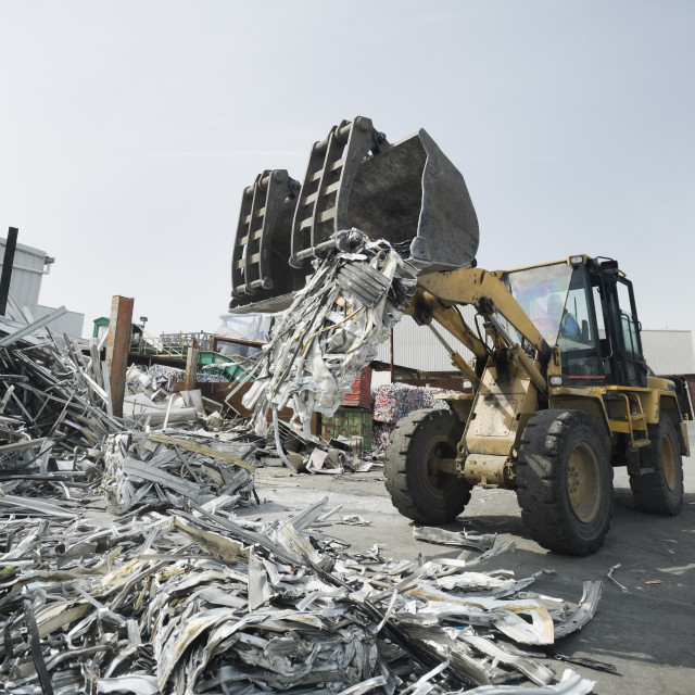 """""""Backhoe lifting recycled metal"""" stock image"""