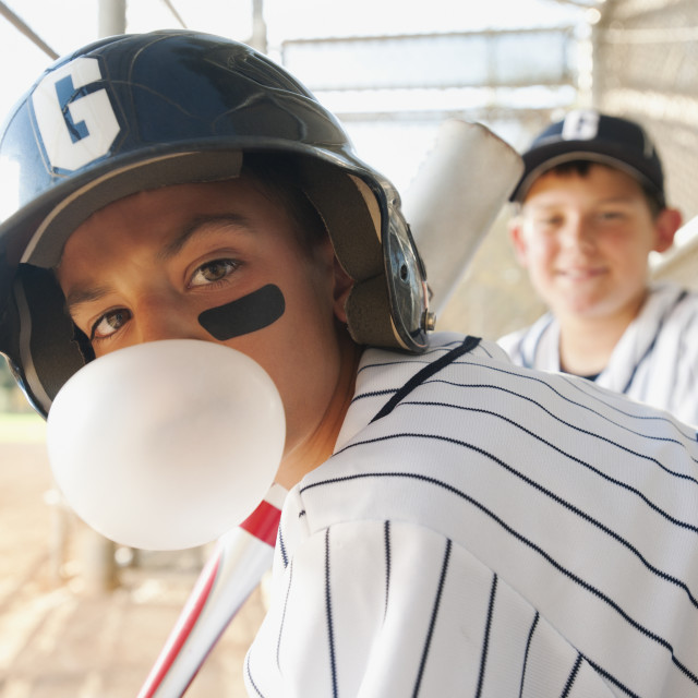 """USA, California, Ladera Ranch, boys (10-11) from little league baseball team on dugout"" stock image"