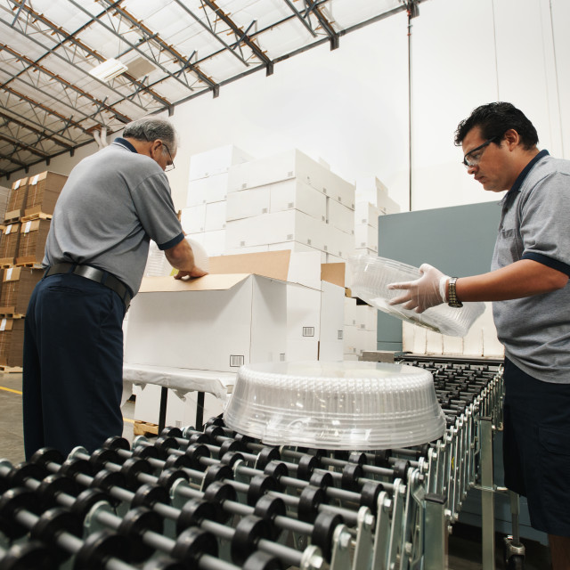 """Warehouse workers assembling merchandise"" stock image"