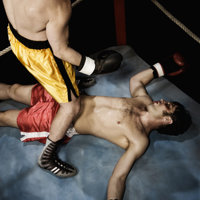 """Boxer standing above knocked out opponent"" stock image"
