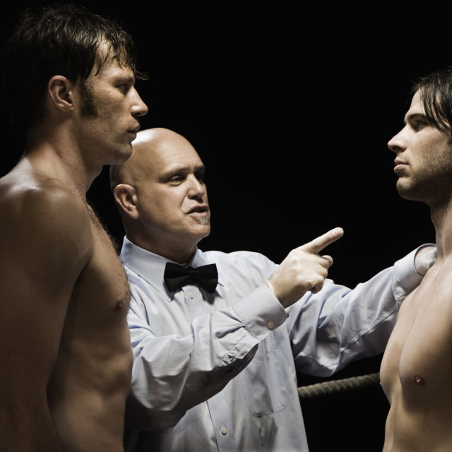 """Referee standing between two boxers"" stock image"