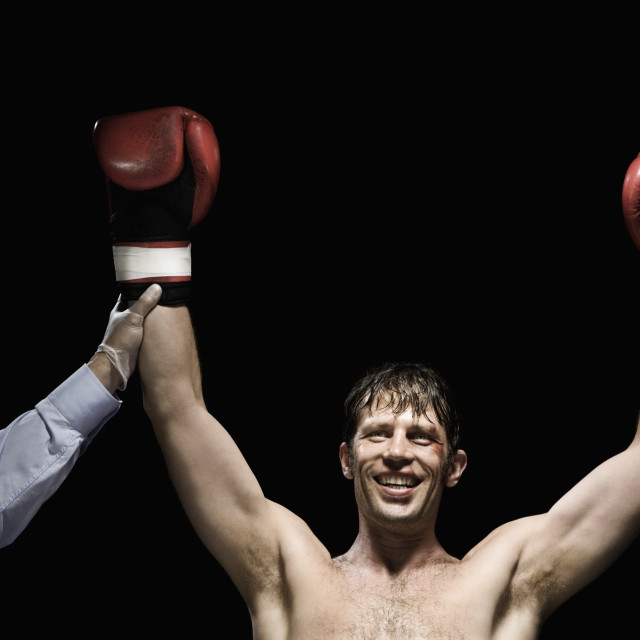 """Boxer with arms raised"" stock image"