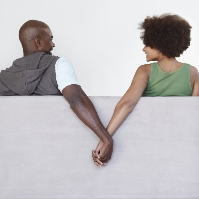"""""""Couple holding hands"""" stock image"""