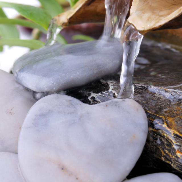 """""""heart-shaped stone in fountain"""" stock image"""