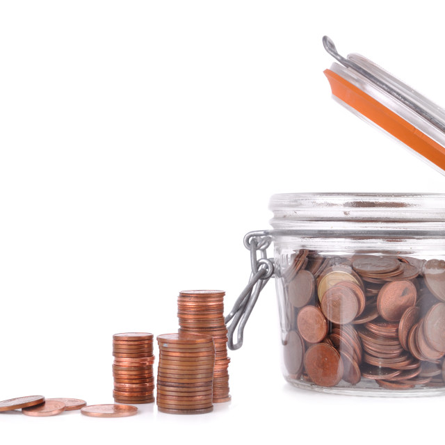 """""""saving coins in a jar"""" stock image"""