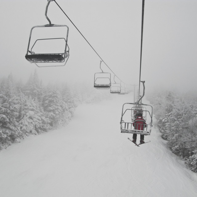 """Skier on chair lift"" stock image"