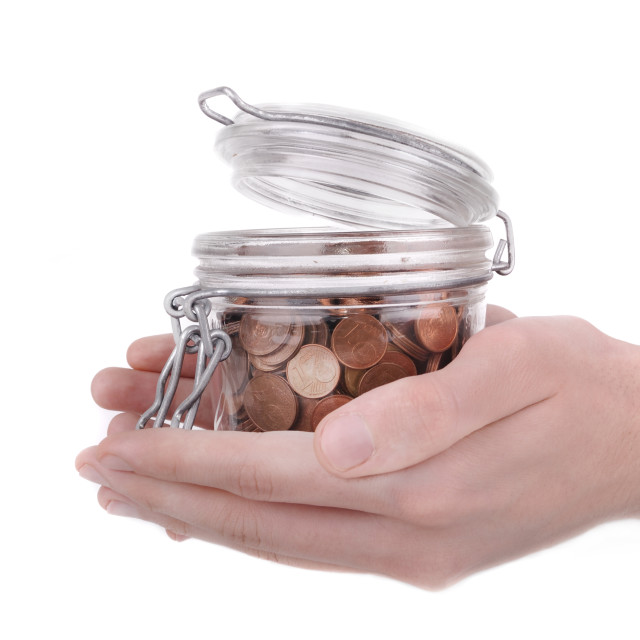 """""""holding a jar full of coins"""" stock image"""