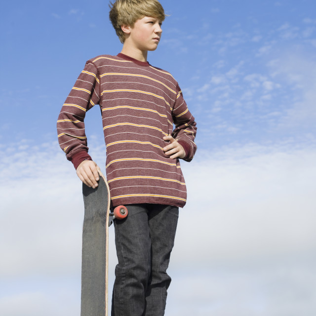 """Boy with skateboard"" stock image"