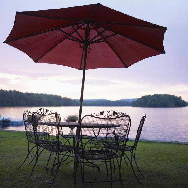 """A patio set by a lake"" stock image"