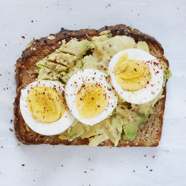 """Toasted bread with avocado and hard boiled egg"" stock image"