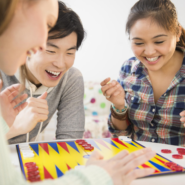 """""""Young women and man playing backgammon"""" stock image"""