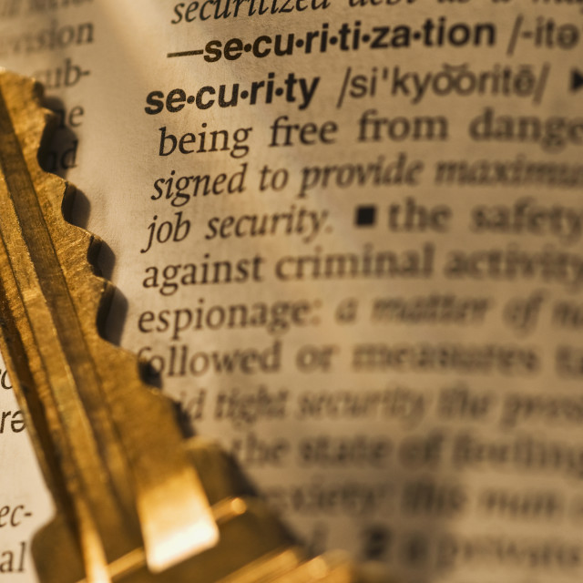 """""""Definition of security in dictionary and key"""" stock image"""
