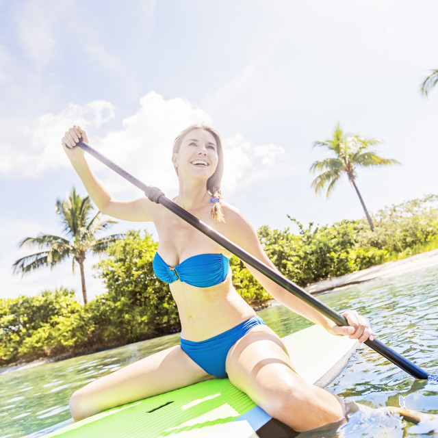 """Woman on paddle board"" stock image"