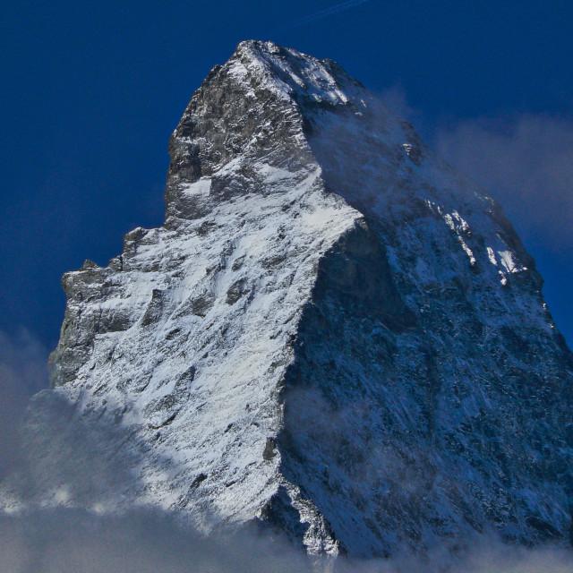 """Aircraft flying over the Matterhorn"" stock image"