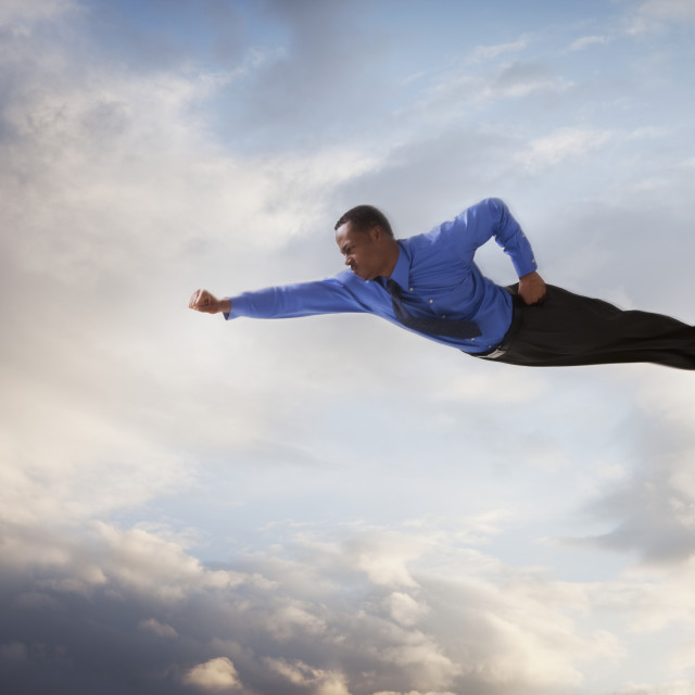"""Businessman flying in the sky"" stock image"