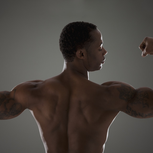 """""""Physically fit man flexing his triceps"""" stock image"""
