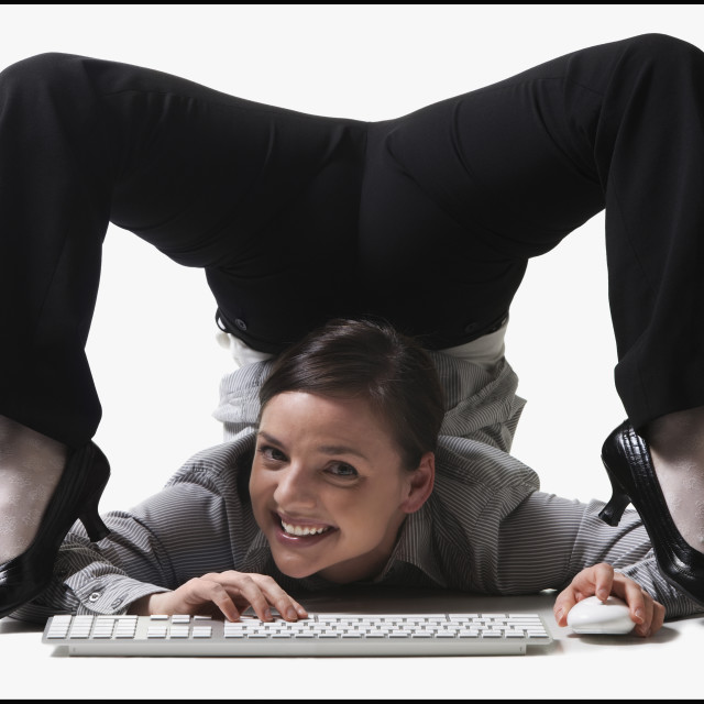 """""""Businesswoman contorting her body while typing"""" stock image"""