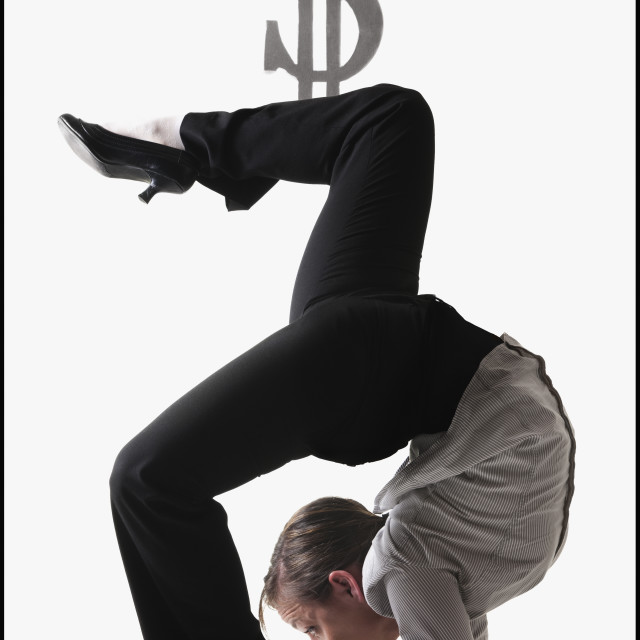"""""""Dollar symbol on top of contorted businesswoman"""" stock image"""