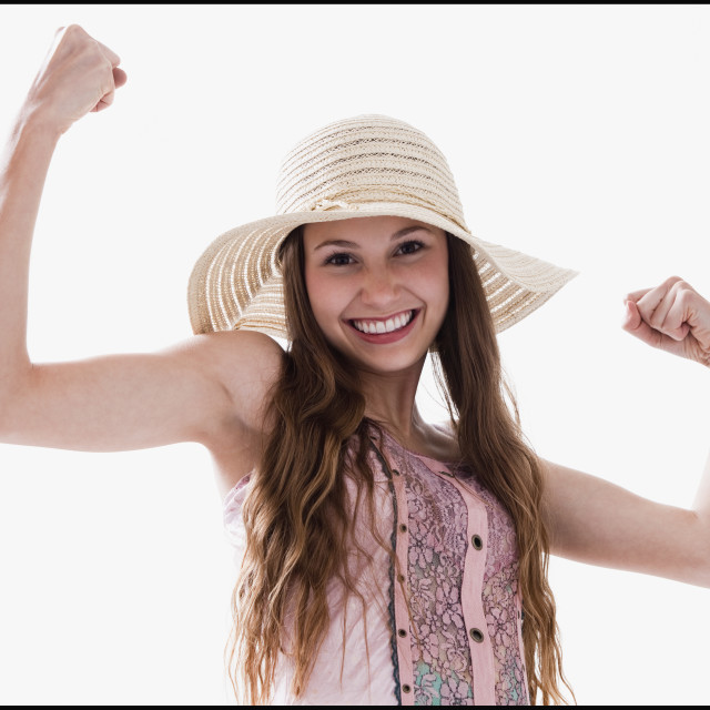 """""""Smiling woman flexing her muscles"""" stock image"""