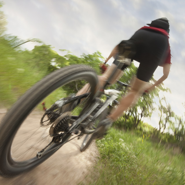 """""""Cyclist on single track trail"""" stock image"""
