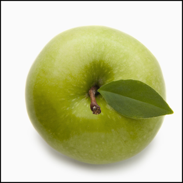 """Studio shot of green apple, directly above"" stock image"