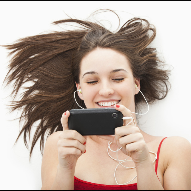 """""""Young woman listening to mp3 player"""" stock image"""