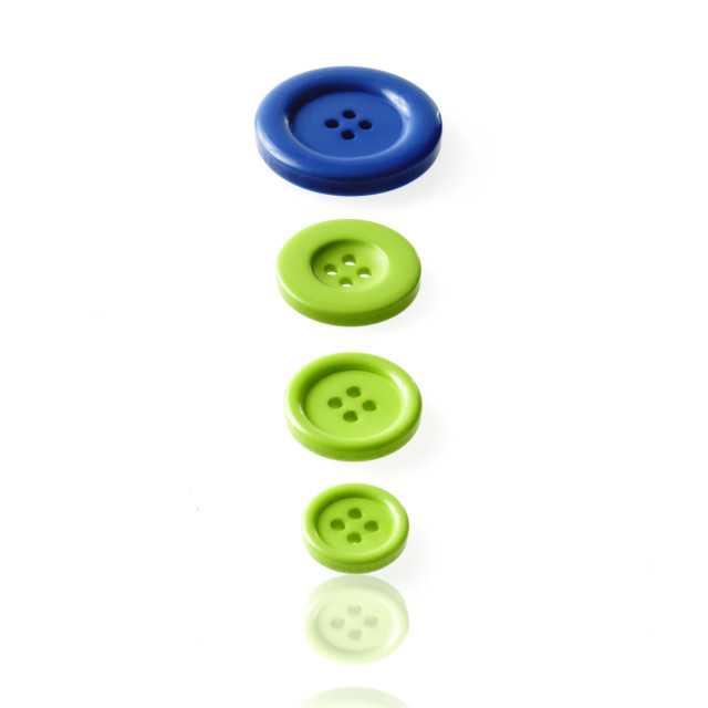 """Studio shot of blue and green buttons in a row"" stock image"