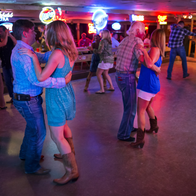 """Austin, Texas - June 13, 2014: People dancing country music in the Broken Spoke dance hall in Austin, Texas, USA"" stock image"