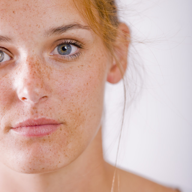 """""""Studio portrait of young woman with freckles"""" stock image"""