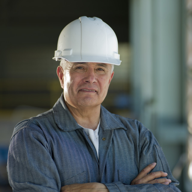 """Portrait of industrial worker wearing hardhat"" stock image"