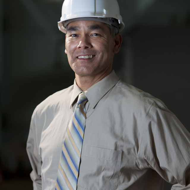 """Portrait of male technician wearing hardhat"" stock image"