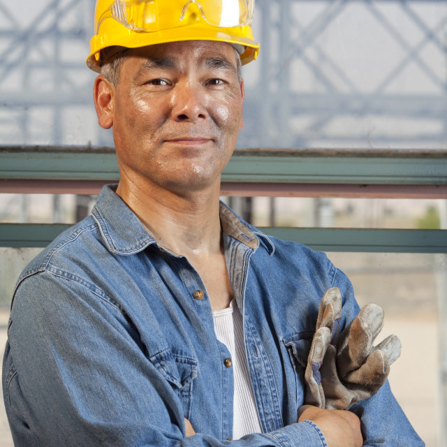 """Portrait of worker wearing hardhat"" stock image"