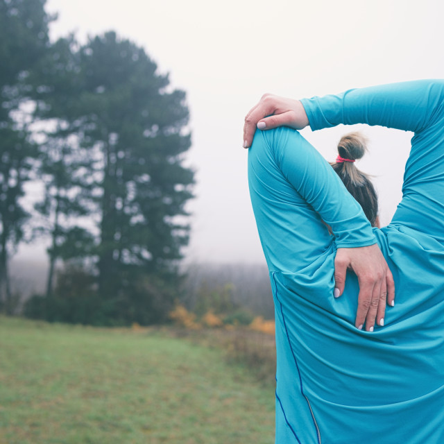 """""""Woman Stretching Outdoors"""" stock image"""