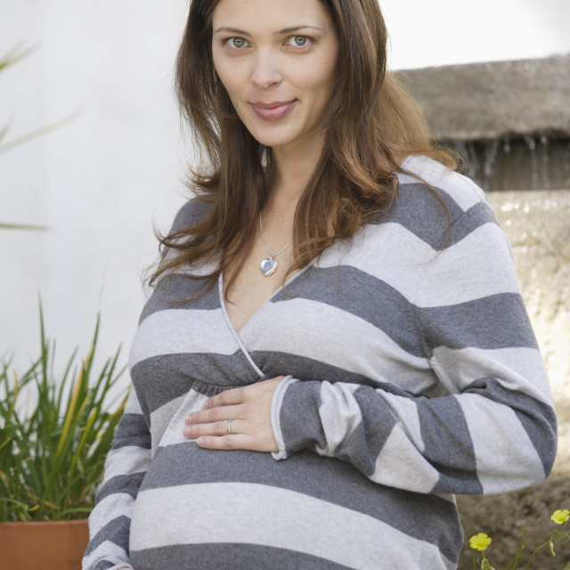 """Portrait of expecting mother"" stock image"
