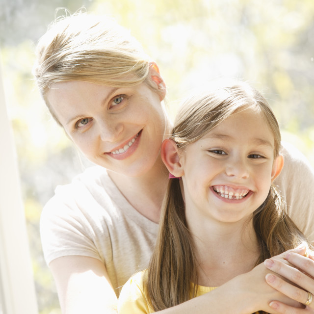 """""""Portrait of daughter (6-7) and mother embracing"""" stock image"""