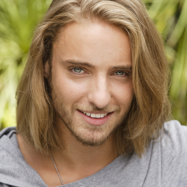 """""""Portrait of young man with long blond hair"""" stock image"""