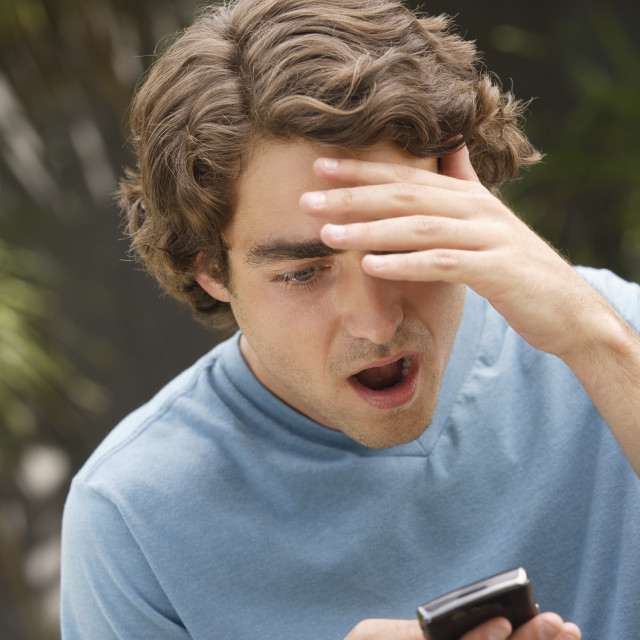 """Young man reading sms"" stock image"