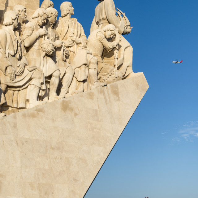 """Aeroplane flying over the Monument of the Discoveries (Padrao dos Descobrimentos) in Lisbon, Portugal; Concept for visit Portugal and Lisbon"" stock image"