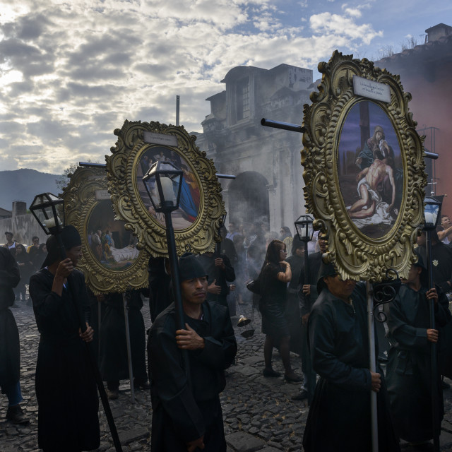"""Antigua, Guatemala - April 19, 2014: People in a street of the old city of Antigua during a procession of the Holy Week, in Antigua, Guatemala"" stock image"