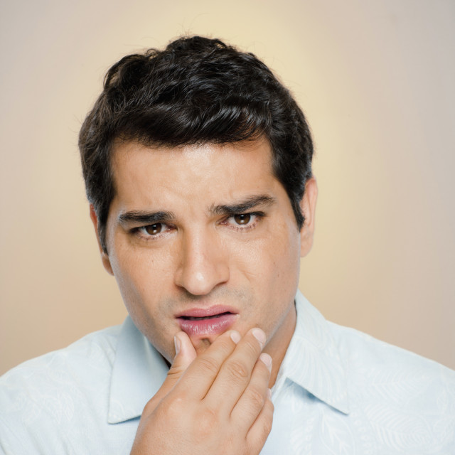 """""""Portrait of man expressing uncertainty"""" stock image"""