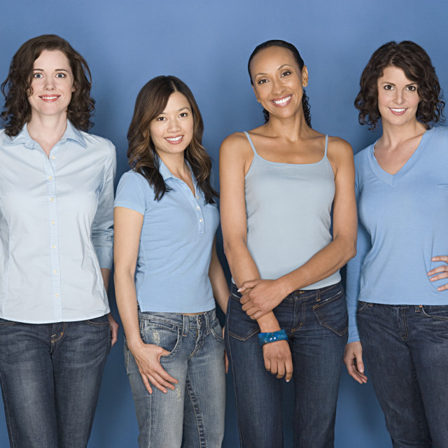 """""""Portrait of four mid adult women including twins"""" stock image"""