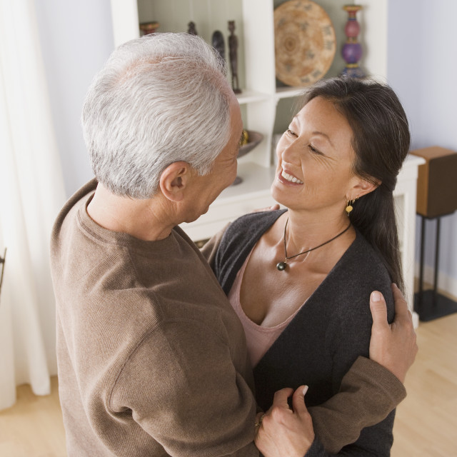 """Older couple in embrace"" stock image"